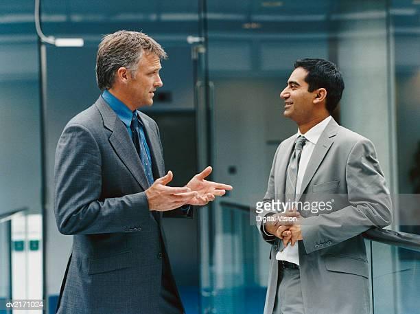 Businessmen Talking in an Office Building