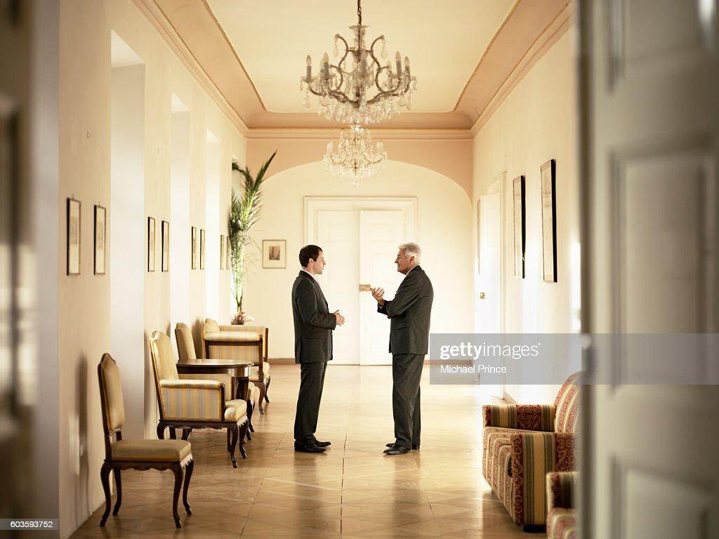 Businessmen Talking in Hallway : Stock Photo