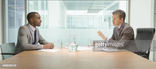 Businessmen talking in meeting