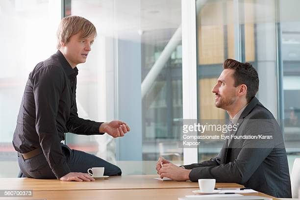"""businessmen talking in meeting - """"compassionate eye"""" stock pictures, royalty-free photos & images"""