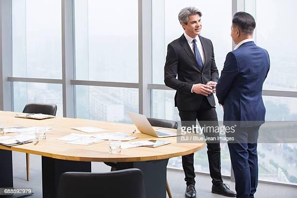 Businessmen talking in meeting room