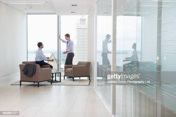 Businessmen talking in office lounge