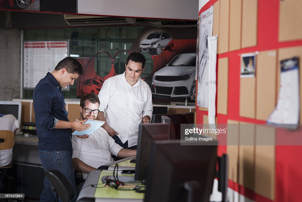 Businessmen talking in office : Stock Photo