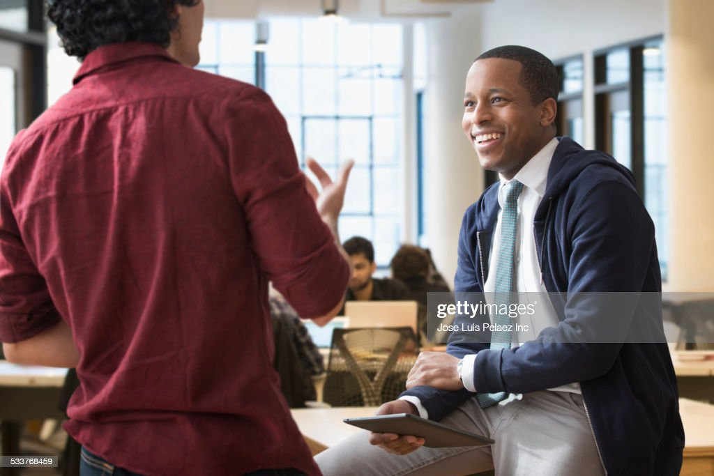 Businessmen talking in office : Foto stock