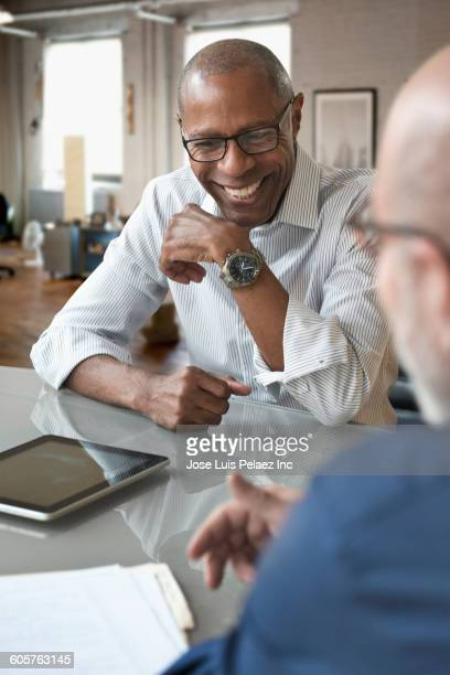 businessmen talking in office - differential focus stock pictures, royalty-free photos & images