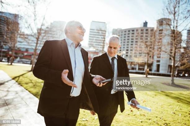 businessmen talking in the city of Melbourne