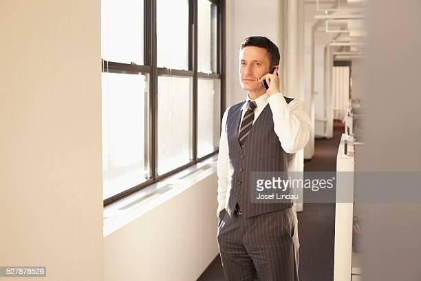 Businessmen using cell phone
