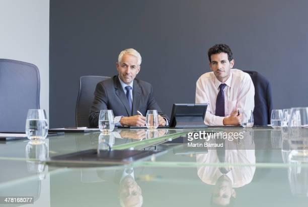 Businessmen using digital tablet in meeting