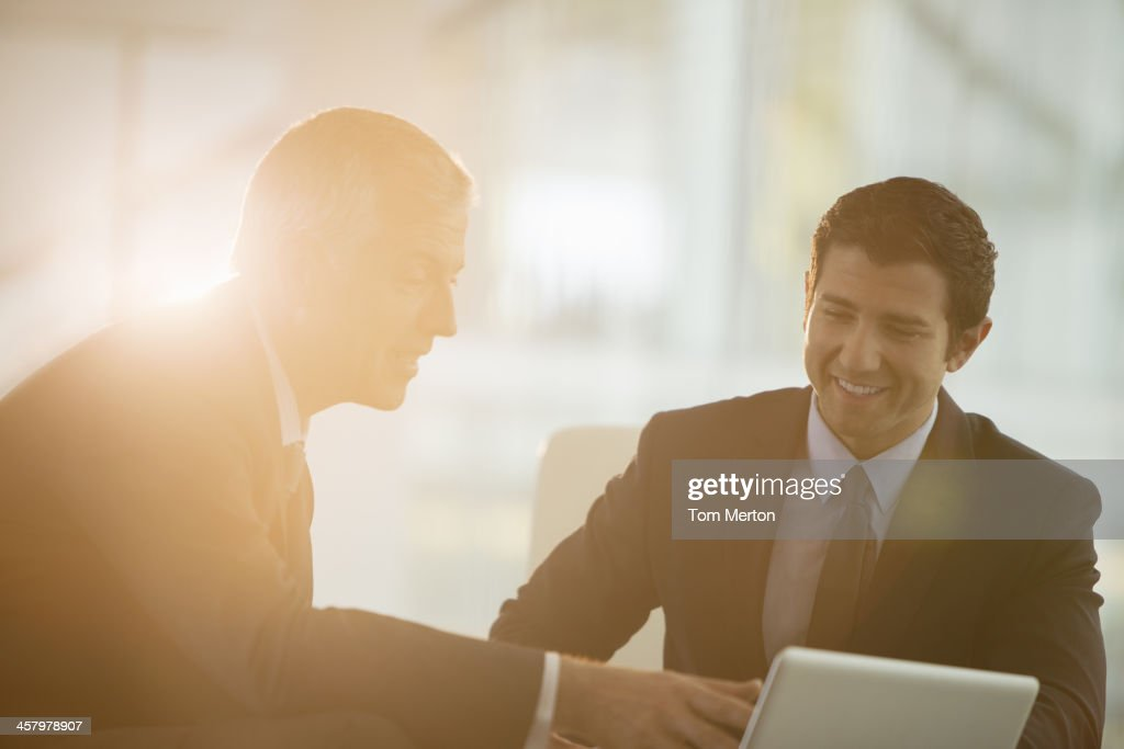 Businessmen using digital tablet in office : Stock Photo