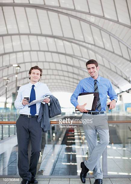 Businessmen waiting in train station
