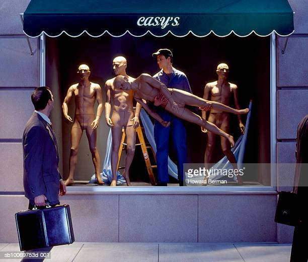 businessmen walking by mannequins worker - mannequin stock pictures, royalty-free photos & images