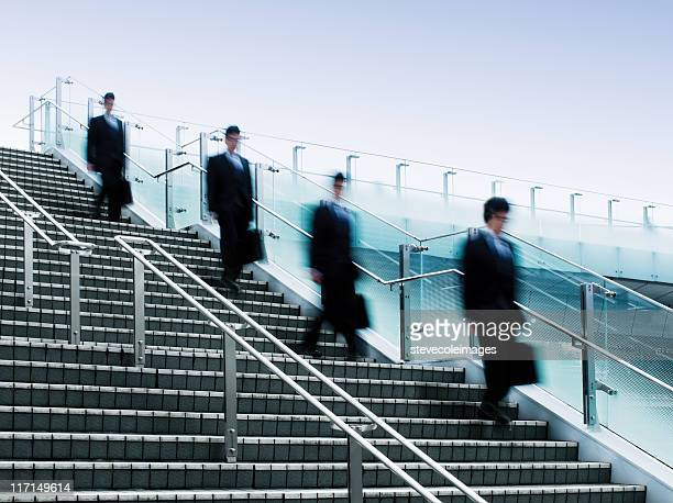 Businessmen Walking Down a Flight of Stairs