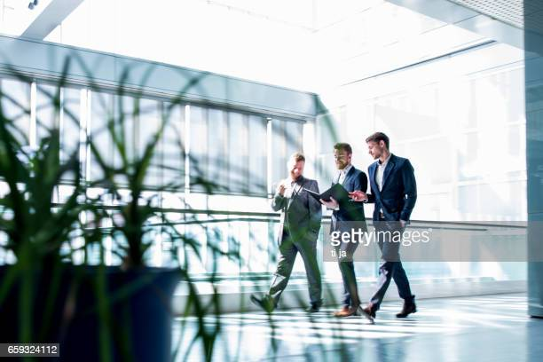Businessmen walking in a hall