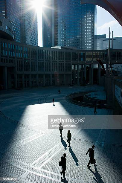 Businessmen walking in plaza,elevated view