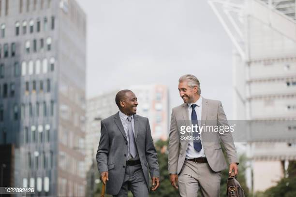 businessmen walking to work - st. james' park newcastle upon tyne stock pictures, royalty-free photos & images