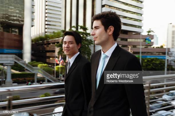 Businessmen walking together outdoors