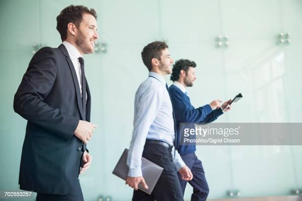 businessmen walking together with confidence - 近く ストックフォトと画像