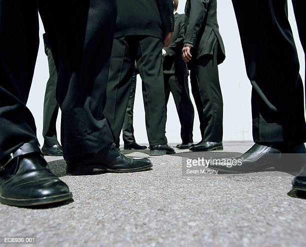 businessmen wearing black suits, outdoors,  low angle view - low section stock pictures, royalty-free photos & images