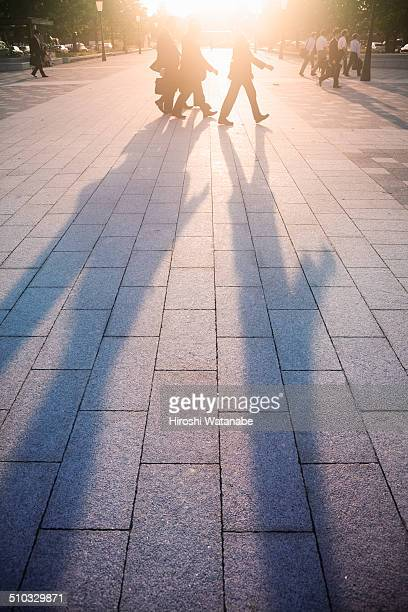 businessmen who pass through plaza,at sun set - moving past stock pictures, royalty-free photos & images