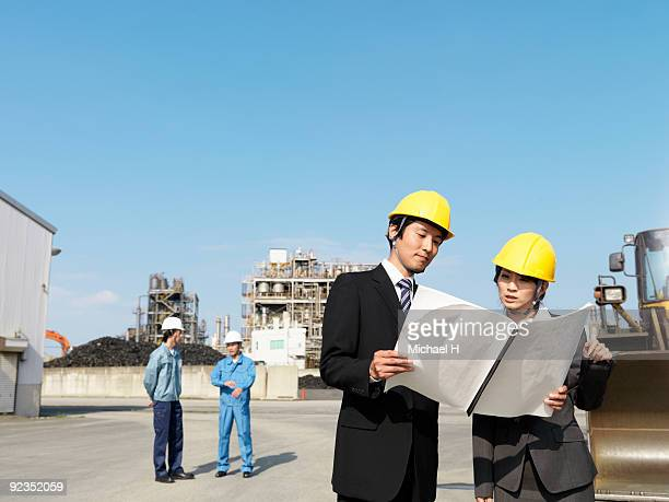 Businessmen who see blueprint