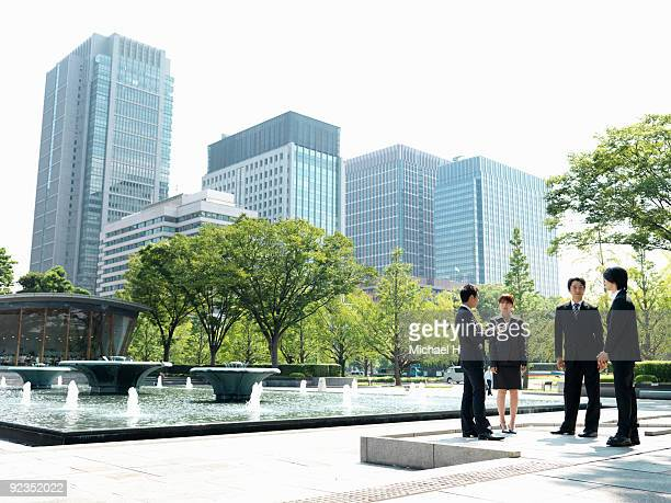 Businessmen who talk outdoors