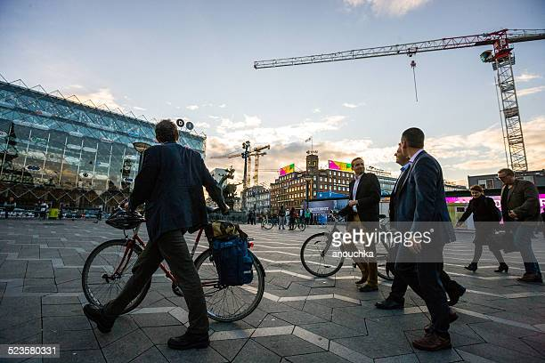 businessmen with a bicycle walking through city hall square, cop - zealand denmark stock pictures, royalty-free photos & images