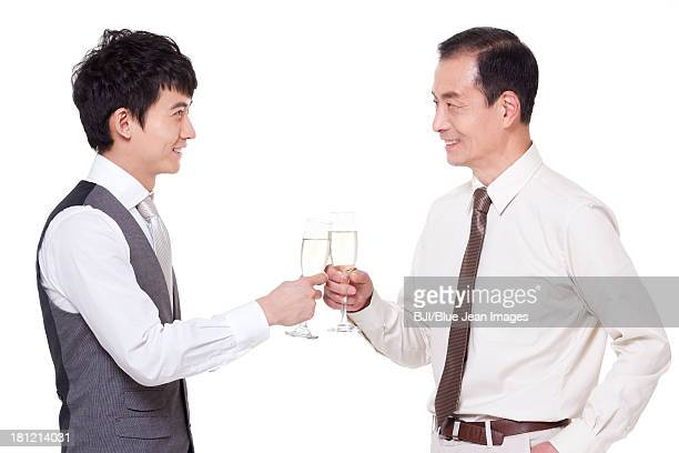 Businessmen with champagne flutes toasting