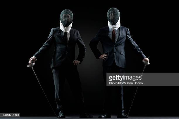 businessmen with fencing masks and foils - face guard sport stock pictures, royalty-free photos & images