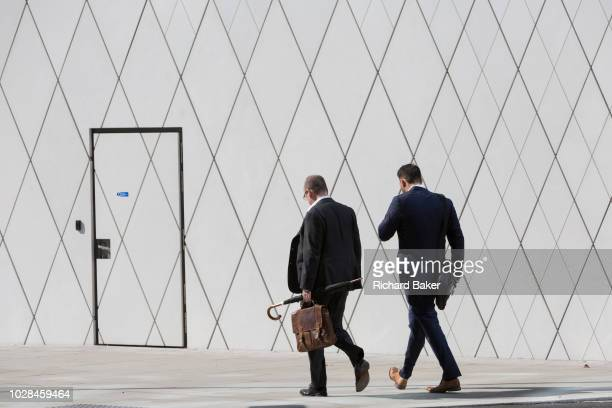 Businessmen with geometric angles and diagonal lines on new architecture at Southwark SE1 on 7th September 2018 in London England