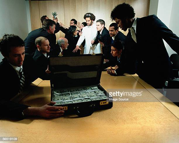 Businessmen with suitcase full of money