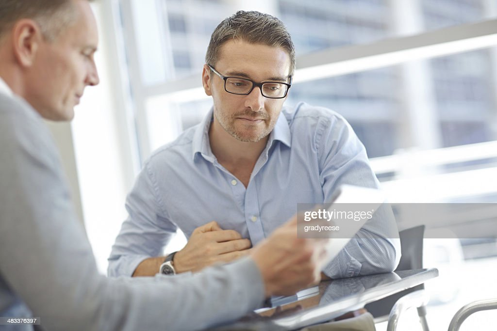 Businessmen with tablet during meeting : Stock Photo