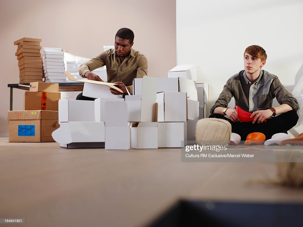 Businessmen working in messy office : Stock Photo