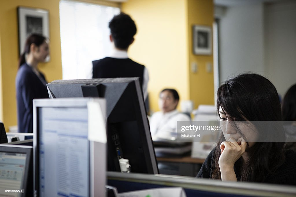 Businessmen working on a computer in the office : Stock Photo