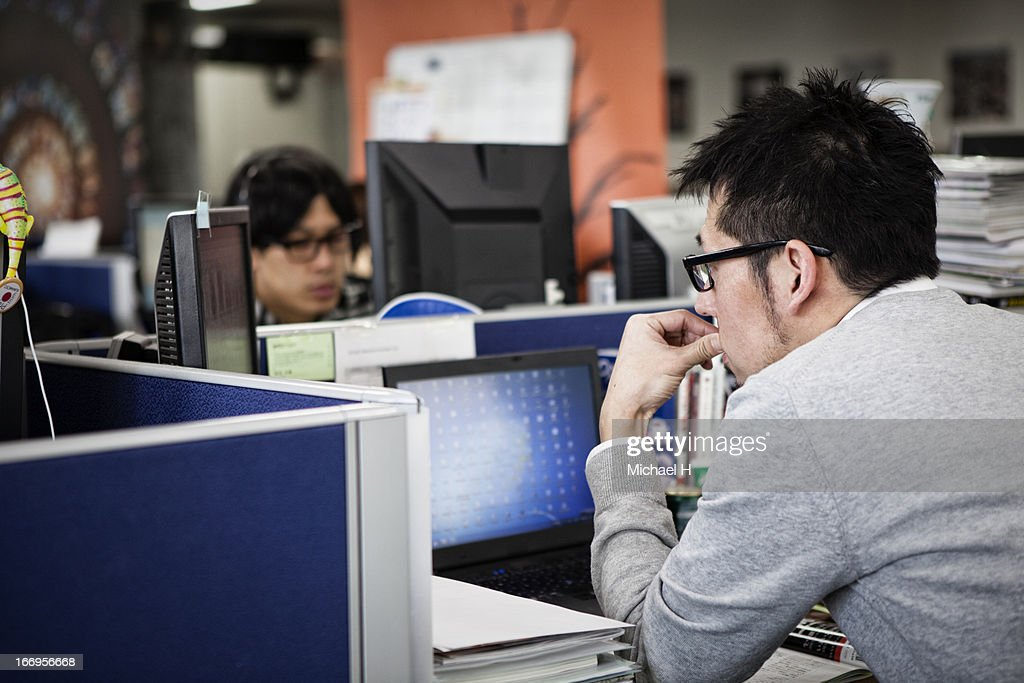 Businessmen working on a computer in the office : ストックフォト