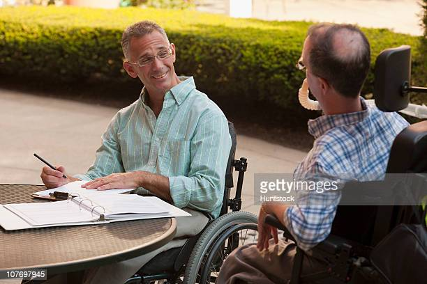 businessmen working on a laptop - duchenne muscular dystrophy stock photos and pictures