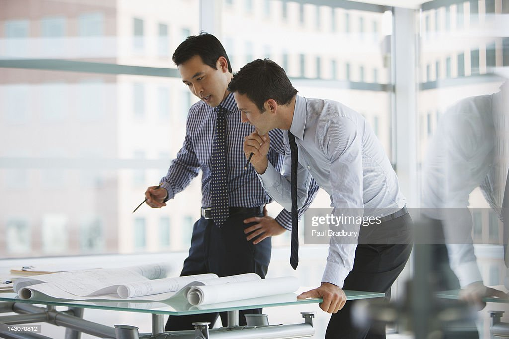 Businessmen working together in office : Stock Photo