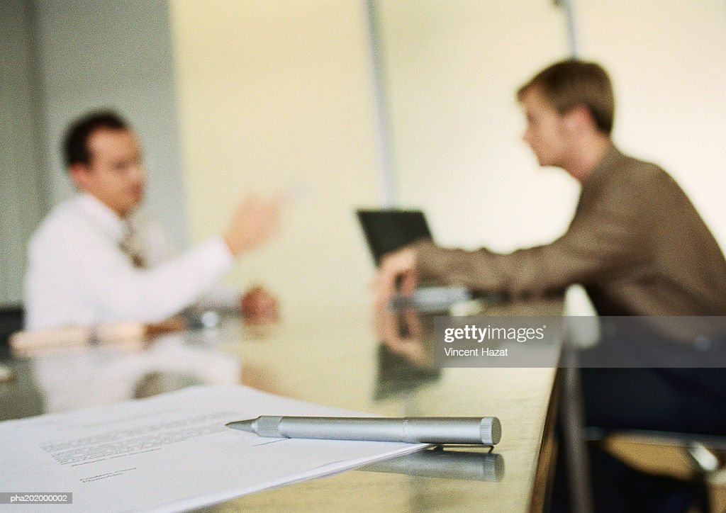 Businessmen working together in office space, blurred. : Stockfoto