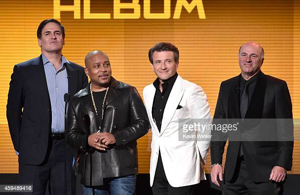 Businessmen/'Shark Tank' cast members Mark Cuban Daymond John Robert Herjavec and Kevin O'Leary speak onstage at the 2014 American Music Awards at...