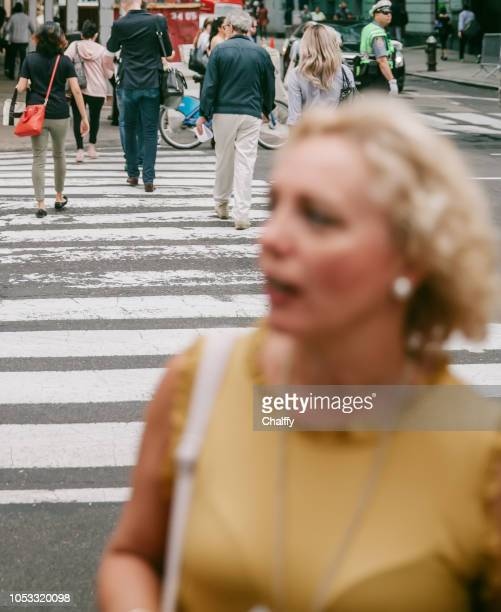 businessmomen at madison avenue - madison grace stock pictures, royalty-free photos & images
