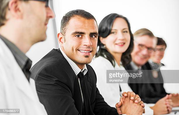 Businesspeople and doctors on a conference.