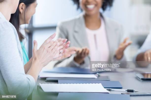 Businesspeople applaud after presentation