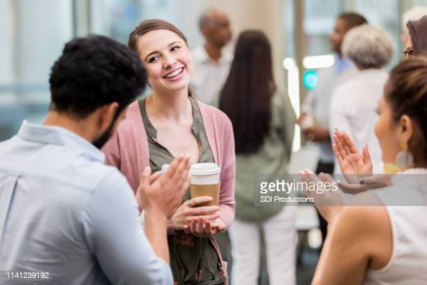 businesspeople applaud colleague - humility stock pictures, royalty-free photos & images