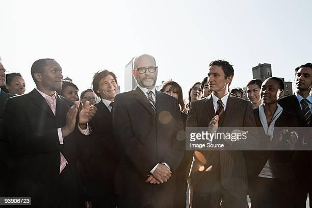 Businesspeople applauding businessmen