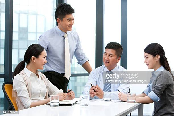 businesspeople around a table - managing director stock pictures, royalty-free photos & images