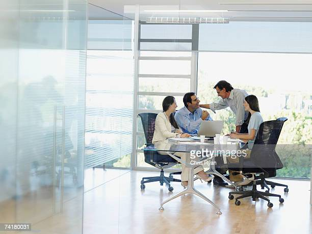 businesspeople at meeting - encouragement stock pictures, royalty-free photos & images