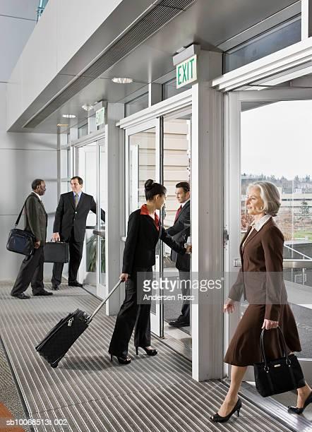 Businesspeople at office doorway