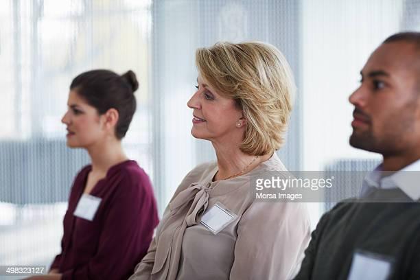 Businesspeople attending seminar