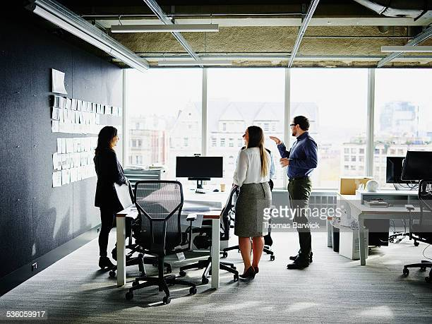 Businesspeople beginning project planning meeting