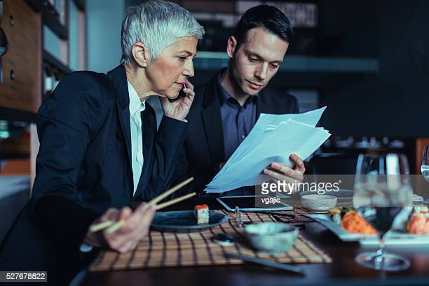 Businesspeople Brainstorming Out Of Office