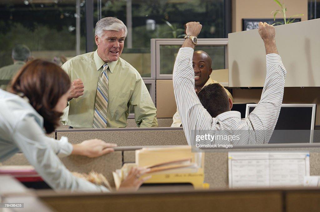 Businesspeople celebrating in office : Stockfoto